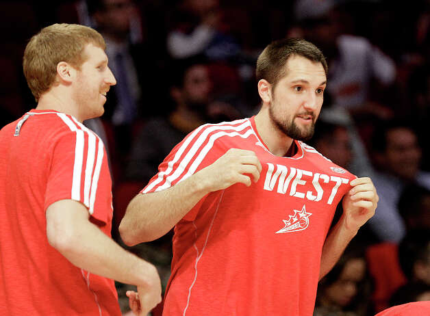 Ryan Anderson of the New Orleans Hornets shows of his Western Conference colors as he and Matt Bonner of the San Antonio Spurs prepare to compete in the NBA All-Star Three-Point Contest at the Toyota Center on All-Star Saturday Night, Saturday, Feb. 16, 2013, in Houston. Photo: Melissa Phillip, Houston Chronicle / © 2013  Houston Chronicle