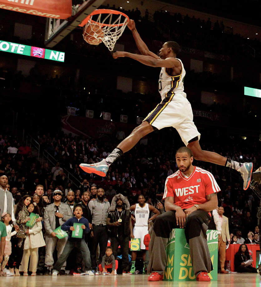 Jeremy Evans of the Utah Jazz  competes in the NBA All-Star Slam Dunk Contest at the Toyota Center on All-Star Saturday Night, Saturday, Feb. 16, 2013, in Houston. Photo: Melissa Phillip, Houston Chronicle / © 2013  Houston Chronicle