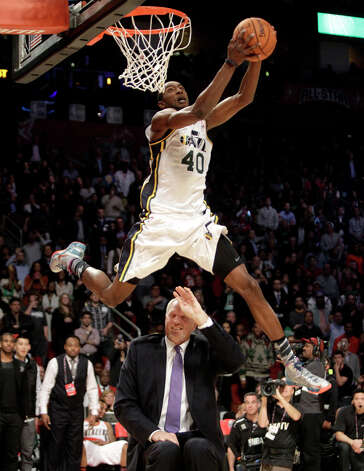 Jeremy Evans of the Utah Jazz dunks over former Jazz player Mark Eaton during the NBA All-Star Slam Dunk Contest at the Toyota Center on All-Star Saturday Night, Saturday, Feb. 16, 2013, in Houston. Photo: Melissa Phillip, Houston Chronicle / © 2013  Houston Chronicle