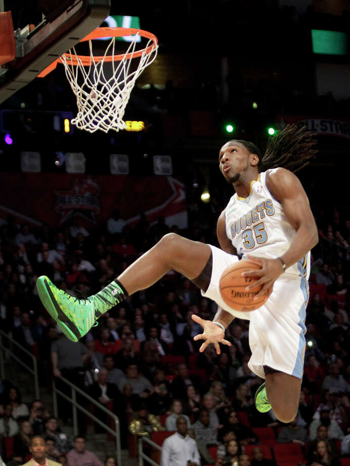 Kenneth Faried of the Denver Nuggets  competes in the NBA All-Star Slam Dunk Contest at the Toyota Center on All-Star Saturday Night, Saturday, Feb. 16, 2013, in Houston. Photo: Melissa Phillip, Houston Chronicle / © 2013  Houston Chronicle