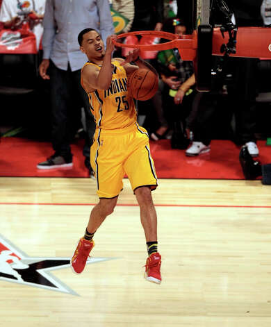 Gerald Green of the Indiana Pacers  tries to complete a double dunk move as he competes in the NBA All-Star Slam Dunk Contest at the Toyota Center on Saturday, Feb. 16, 2013, in Houston. Photo: Billy Smith II, Houston Chronicle / © 2013 Houston Chronicle