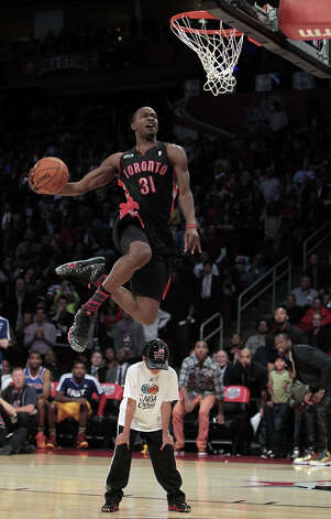 Terrence Ross of the Toronto Raptors competes in the NBA All-Star Slam Dunk Contest at the Toyota Center on All-Star Saturday Night, Saturday, Feb. 16, 2013, in Houston. Photo: James Nielsen, Houston Chronicle / © 2013  Houston Chronicle