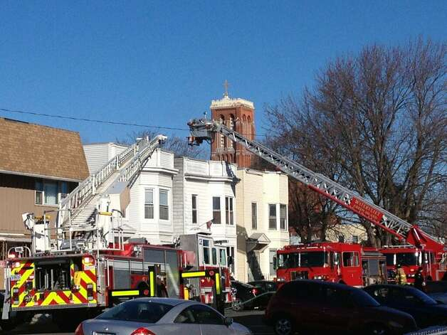 Fourth Avenue was closed near 19th Street after firefighters battled a house fire at 1817 Fourth Avenue in Watervliet, N.Y. (Bryan Fitzgerald / Times Union)