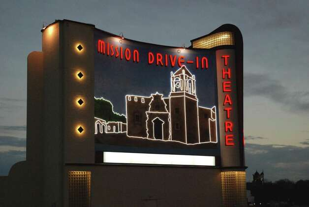 The lights of the new Mission Drive-In Theatre mural were turned on during the city's official lighting ceremony Feb. 12. Photo: Steve Valdez/ For The Southside