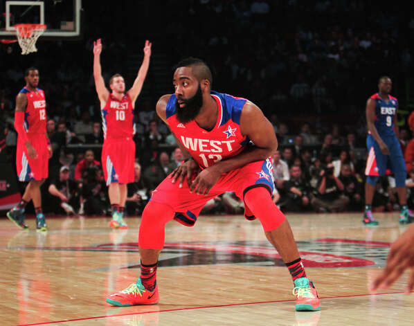 James Harden of the Houston Rockets celebrates after hitting a three-point shot during the second half. Photo: James Nielsen, Houston Chronicle / © 2013  Houston Chronicle