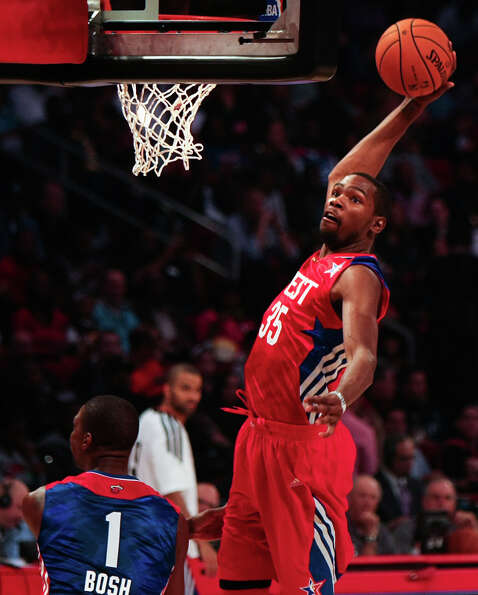 Kevin Durant of the Oklahoma City Thunder (35) dunks the ball over Chris Bosh of the Miami Heat (1)