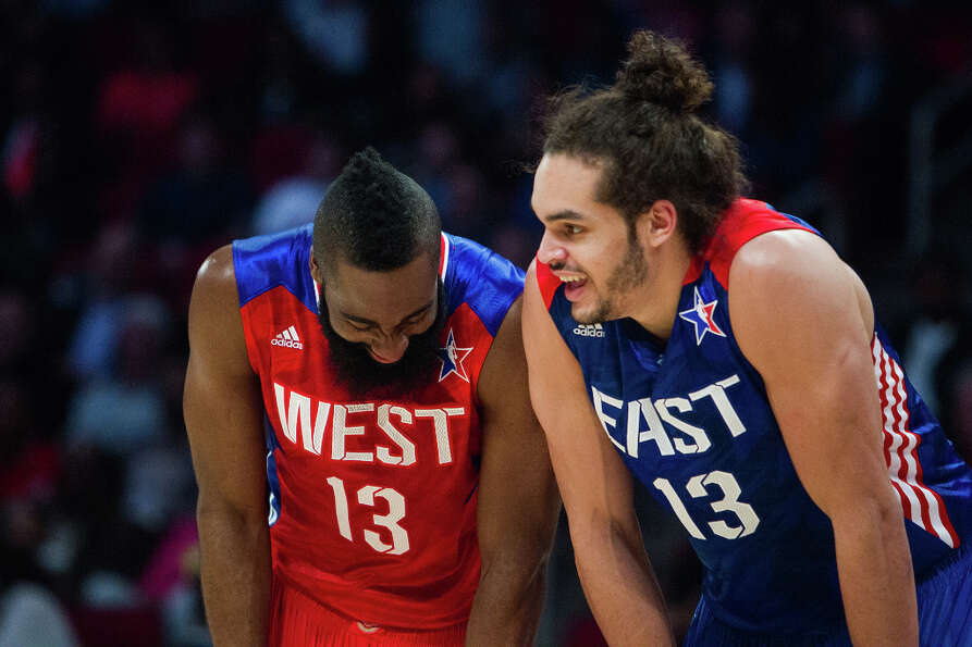 James Harden of the Houston Rockets (13) laughs with Joakim Noah of the Chicago Bulls (13).
