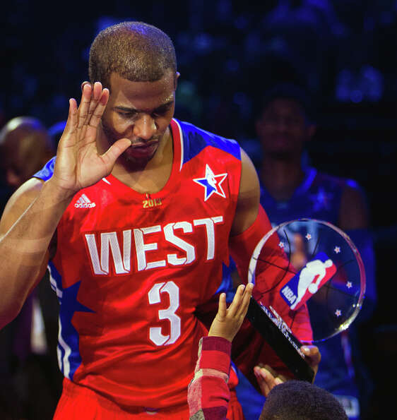 Chris Paul of the Los Angeles Clippers celebrates with the game MVP trophy with his son Chris Paul I