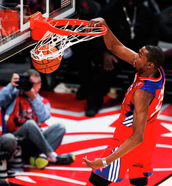 Kevin Durant of the Oklahoma City Thunder (35) goes up for a dunk.