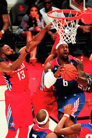 LeBron James of the Miami Heat (6) drives past James Harden of the Houston Rockets (13) during the second half. Photo: Cody Duty, Houston Chronicle / © 2013  Houston Chronicle