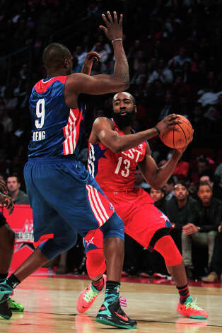 James Harden of the Houston Rockets (13) tries to get around Luol Deng of the Chicago Bulls (9) during the second half. Photo: James Nielsen, Houston Chronicle / © 2013  Houston Chronicle