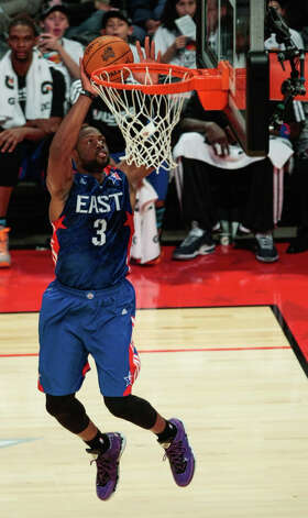 Dwyane Wade of the Miami Heat (3) goes up for a dunk. Photo: Billy Smith II, Houston Chronicle / © 2013  Houston Chronicle