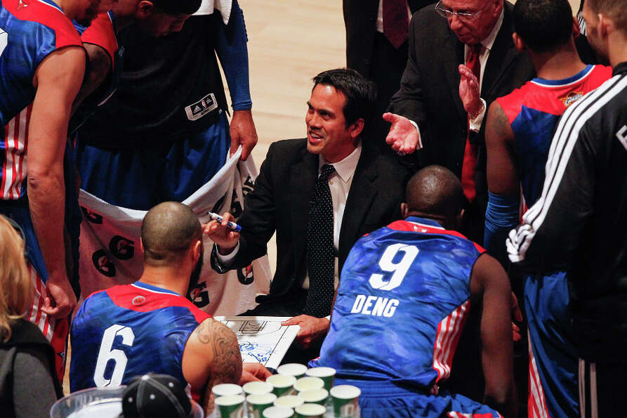 East head coach Erik Spoelstra of the Miami Heat huddles his team.