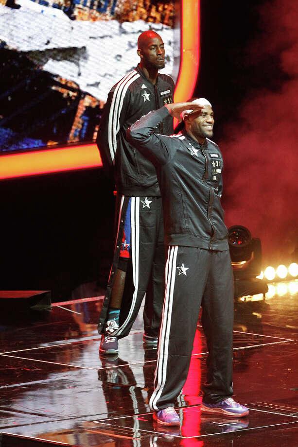 LeBron James of the Miami Heat salutes the crowd before the game. Photo: Cody Duty, Houston Chronicle / © 2013  Houston Chronicle