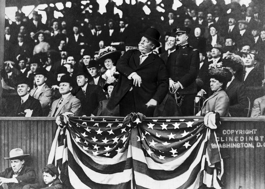Over one hundred years ago, President William Howard Taft, a portly right-hander, threw out the first ball at a Washington Senators game, a weak lob from the stands to the great Walter Johnson. Note that the President didn't throw a first pitch but stayed up in the stands. Photo: NYT / NYTNS
