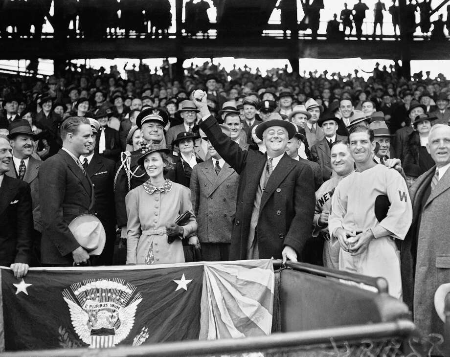 Three years later, FDR prepares to throw the traditional first pitch in Washington once again. No report on whether this throw was less erratic. Photo: Anonymous, Associated Press 1936 / AP