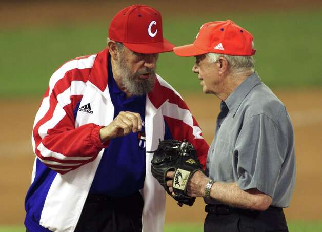 Former U.S. President Jimmy Carter talks with Cuban President Fidel Castro after a friendly game between Cuba and the U.S at the Latinoamericano stadium in Havana in 2002. Carter's visit, the most important by an American since Castro took power, was an attempt to bridge four decades of Cold War feuding between Washington and Havana. Photo: RAFAEL PEREZ, REUTERS / X00660