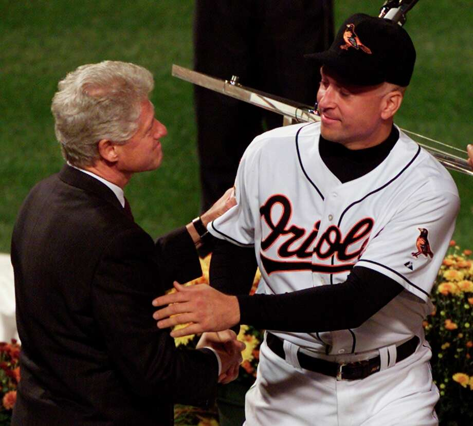 Baltimore Orioles' Cal Ripken Jr. greets former President Bill Clinton during pre-game retirement ceremonies for Ripken in Baltimore, October 6, 2001. Clinton was among the dignitaries and former players who spoke about Ripken's career contributions during the ceremony. Photo: LARRY DOWNING, REUTERS / X00961
