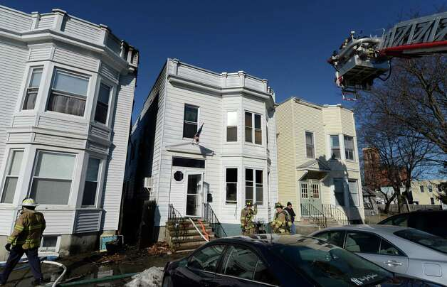 Firefighters respond to a blaze Monday morning, Feb. 18, 2013, at 1817 4th Avenue, in Watervliet, N.Y. Mutual aid fire companies from Green Island and Troy also responded. (Skip Dickstein/Times Union) Photo: SKIP DICKSTEIN