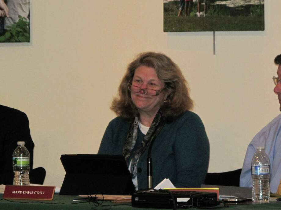 Board of Finance member Mary Cody ponders information about funding for street maintenance at the Feb. 12 BOF meeting. New Canaan, Conn. Photo: Tyler Woods