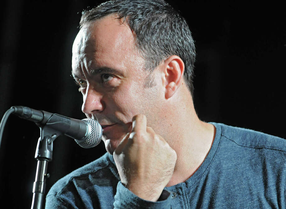 Dave Matthews talks about one of his molar teeth before the warm up band hits the stage in a concert at Saratoga Performing Arts Center June 8, 2012 in Saratoga Springs, N.Y.  (Lori Van Buren / Times Union) Photo: Lori Van Buren, Albany Times Union / 00017954A