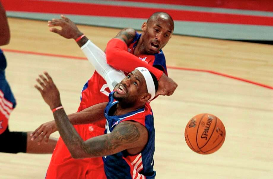 LeBron James has his shot blocked by Kobe Bryant during the second half. Photo: Billy Smith II / © 2013  Houston Chronicle