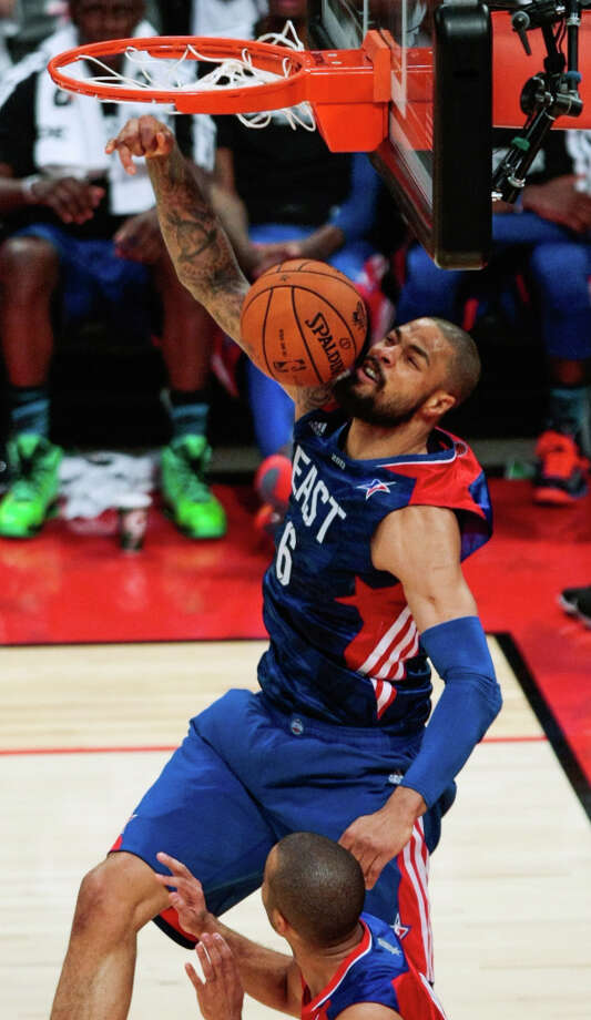 Tyson Chandler of the New York Knicks (6) goes up for a dunk. Photo: Billy Smith II, Houston Chronicle / © 2013  Houston Chronicle