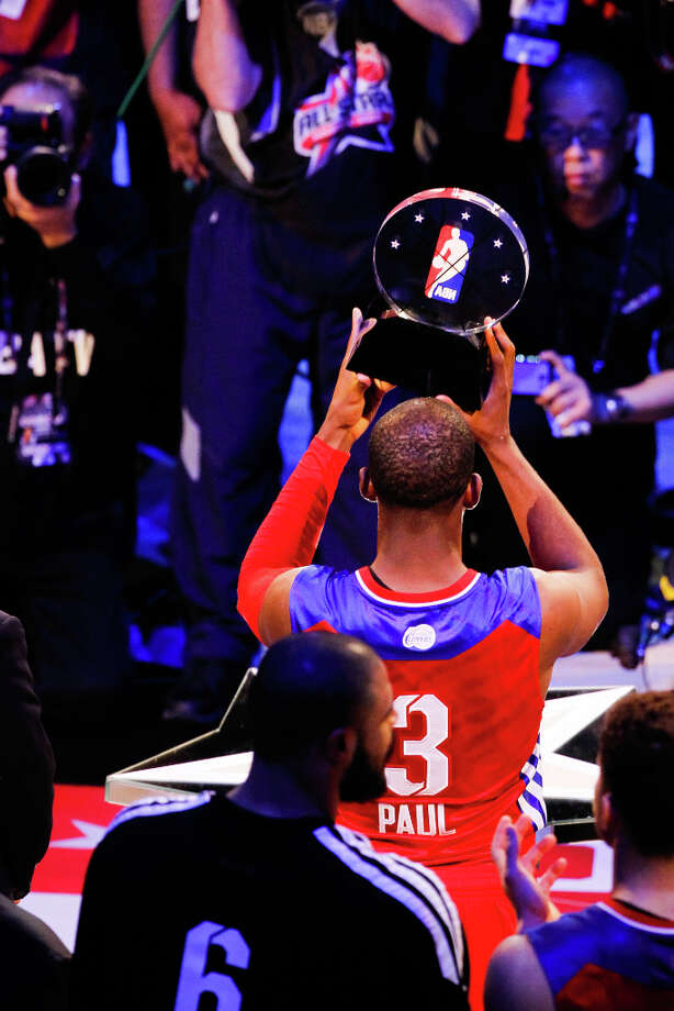 Chris Paul of the Los Angeles Clippers celebrates with the game MVP trophy. Photo: Cody Duty, Houston Chronicle / © 2013  Houston Chronicle
