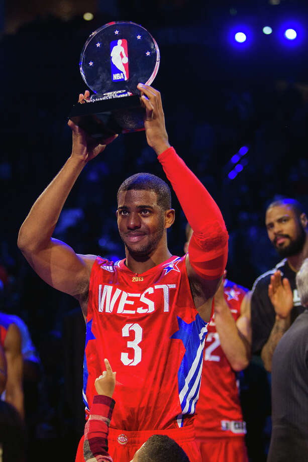 Chris Paul of the Los Angeles Clippers celebrates with the game MVP trophy with his son Chris Paul II. Photo: James Nielsen, Houston Chronicle / © 2013  Houston Chronicle