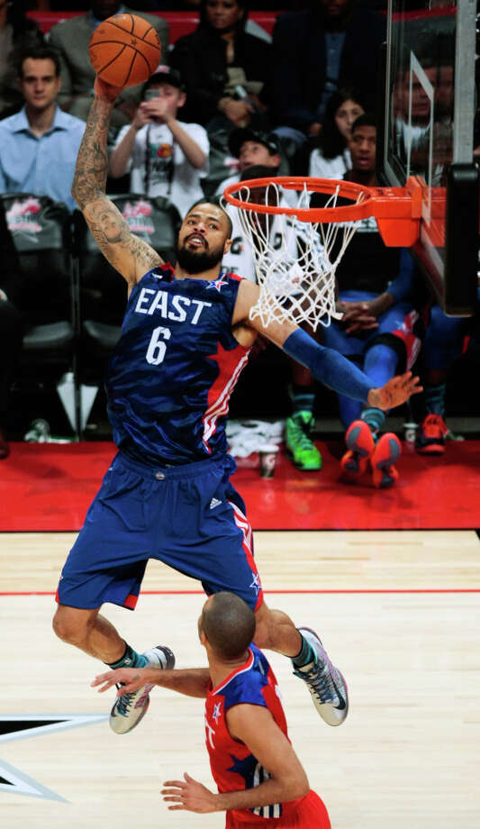 Tyson Chandler of the New York Knicks goes up for a dunk. Photo: Billy Smith II, Houston Chronicle / © 2013  Houston Chronicle