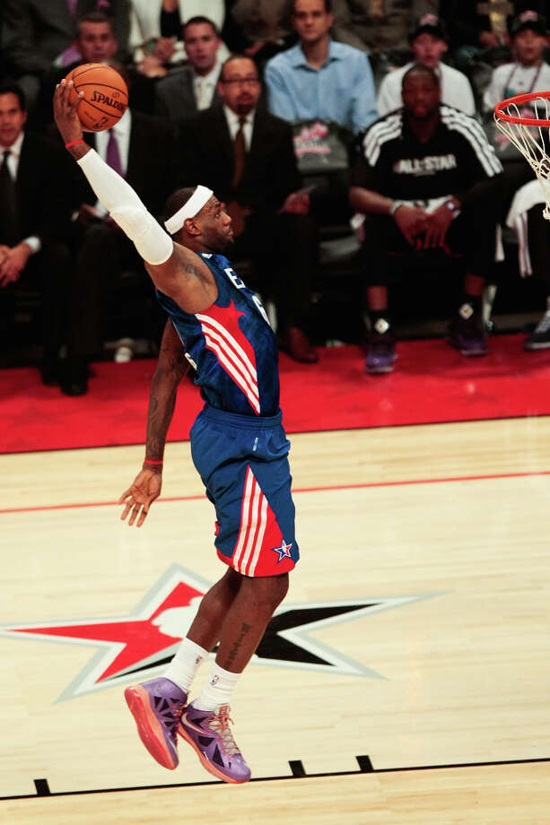 LeBron James of the Miami Heat goes up for a dunk. Photo: Billy Smith II, Houston Chronicle / © 2013  Houston Chronicle