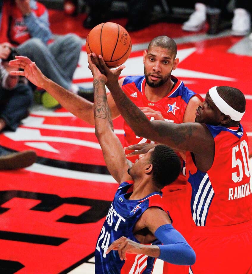 Paul George of the Indiana Pacers (24) fights for a rebound with Zach Randolph of the Memphis Grizzlies (50) and Tim Duncan of the San Antonio Spurs (21). Photo: Cody Duty, Houston Chronicle / © 2013  Houston Chronicle