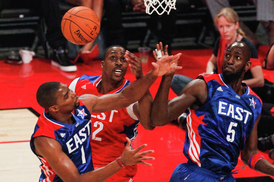 Chris Bosh of the Miami Heat (1), Kevin Garnett of the Boston Celtics (5) and Dwight Howard of the Los Angeles Lakers (12) fight for a rebound. Photo: Cody Duty, Houston Chronicle / © 2013  Houston Chronicle