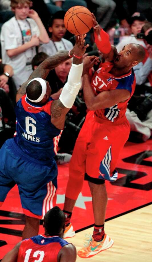 LeBron James his shot blocked by Kobe Bryant during the second half. Photo: Billy Smith II / © 2013  Houston Chronicle