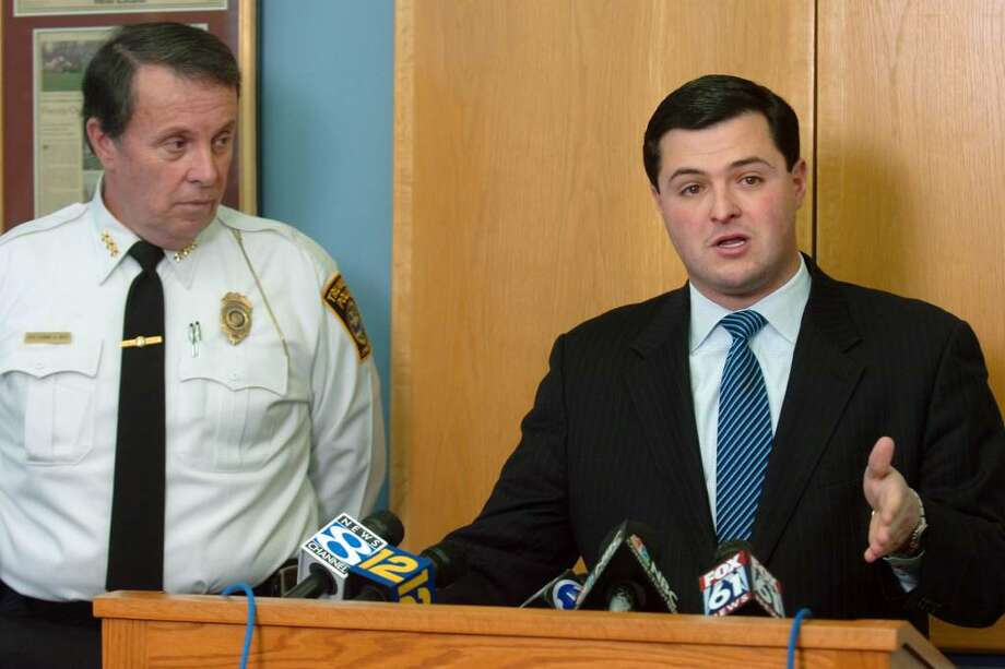 Trumbull First Selectman Tim Herbst, seen here with Police Chief Thomas Kiely, speaks during a press conference at Trumbull Town Hall, in Trumbull, Conn. Dec. 30th, 2009. Photo: Ned Gerard / Connecticut Post