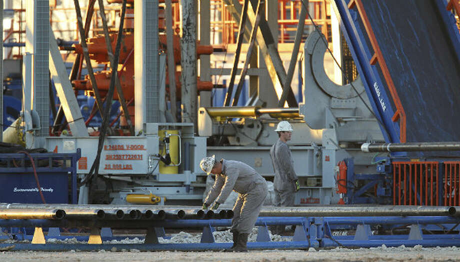 Oil field workers prepare pipe at the Patterson-UTI Energy Rig 248 on FM 99 in Live Oak County near Whisett, Texas. Since 2009, OSHA has opened two fatality investigations in South Texas of Patterson-UTI Drilling Co. LLC, a large drilling company based in Houston.