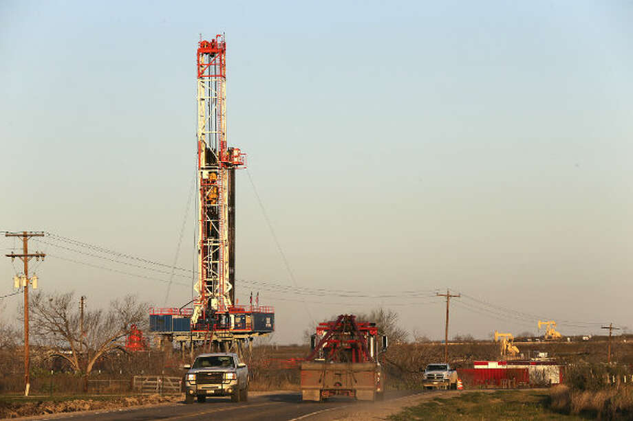 Traffic moves along FM 99 in Live Oak County near Whisett, Texas, past a Patterson-UTI Energy drilling rig. Since 2009, OSHA has opened two fatality investigations in South Texas of Patterson-UTI Drilling Co. LLC, a large drilling company based in Houston.