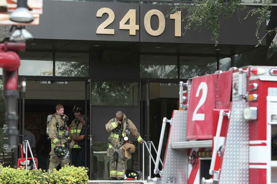 Firefighters are at the scene of a reported two-alarm fire in southwest Houston. Photo: Mayra Beltran/Chronicle