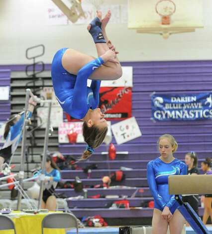 Sarah Petti of Darien High School dismounts the balance beam during the 2013 FCIAC Girls Gymnastics Championships at Westhill High School in Stamford, Saturday, Feb. 16, 2013. Photo: Bob Luckey / Greenwich Time