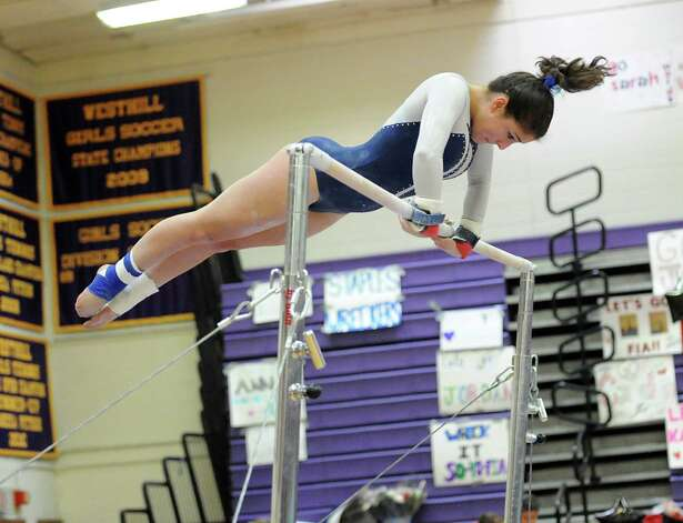Payton Piedmont of Wilton High School competes on the uneven bars during the 2013 FCIAC Girls Gymnastics Championships at Westhill High School in Stamford, Saturday, Feb. 16, 2013. Photo: Bob Luckey / Greenwich Time