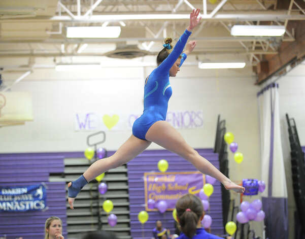 Sarah Petti of Darien High School on the balance beam during the 2013 FCIAC Girls Gymnastics Championships at Westhill High School in Stamford, Saturday, Feb. 16, 2013. Photo: Bob Luckey / Greenwich Time