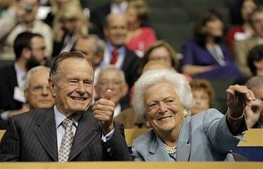 Former President George H.W. Bush and his wife, Barbara, wave to friends in the crowd during the Republican National Convention in St. Paul, Minn., Tuesday, Sept. 2, 2008. Photo: Jae C. Hong, AP / AP