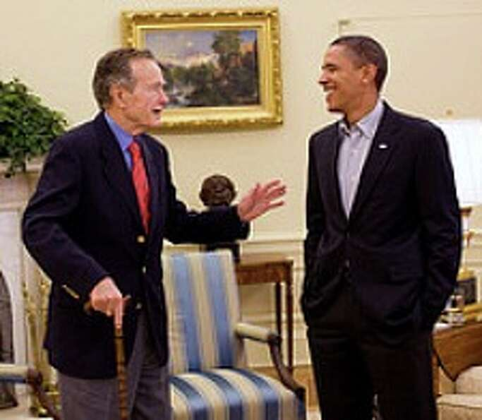 President Barack Obama meets with form President George H.W. Bush in the Oval Office Saturday, Jan.