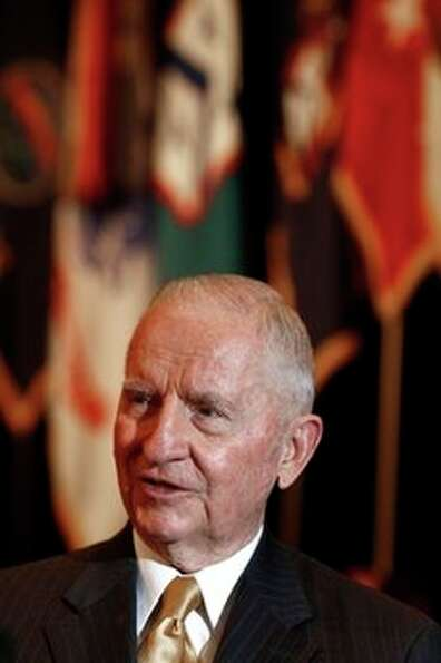 Texas billionaire and two-time presidential candidate Ross Perot talk to members of the media before