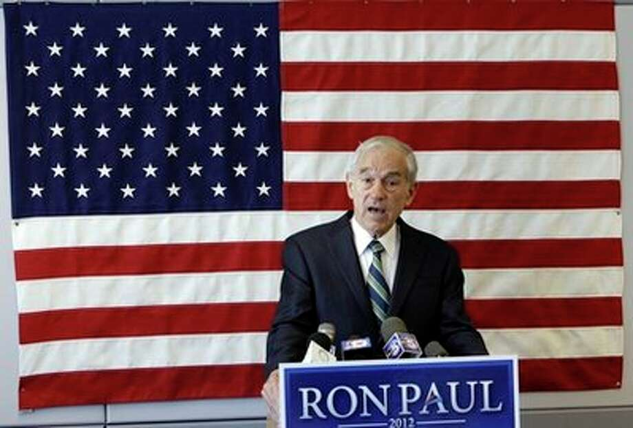 U.S. Rep. Ron Paul, R-Texas, speaks during a news conference at his newly opened Iowa campaign office, Tuesday, May 10, 2011, in Ankeny, Iowa. Photo: AP