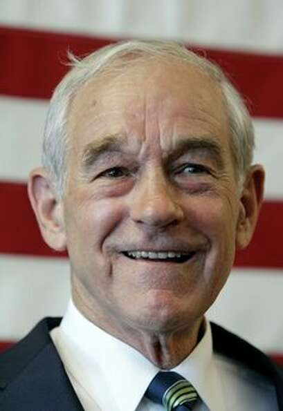 U.S. Rep. Ron Paul, R-Texas, speaks during a news conference at his newly opened Iowa campaign offic