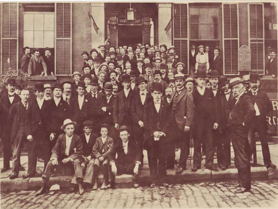 Group of Printers shown during a Labor Day meeting outside of the Times Union on Beaver Street. 1904. Albany Institute of History and Art.
