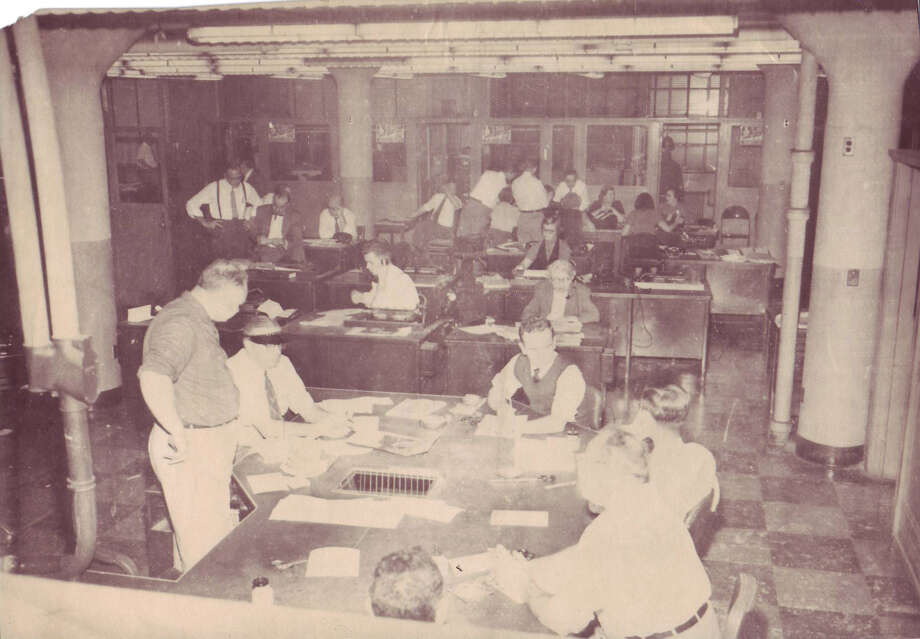 Times Union Sheridan Avenue Newsroom. Employees following election night coverage in 1952. Albany Institute of History and Art.
