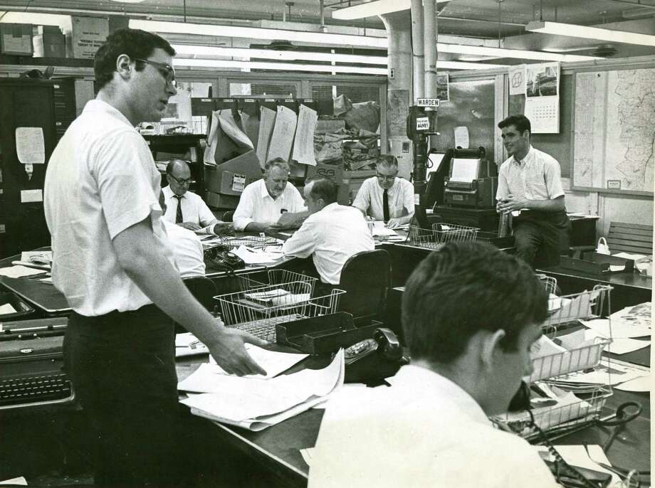 Tu Copy Desk, including current employee Terry Brown in the background on the far right - circa 1960s (courtesy of maguire family)