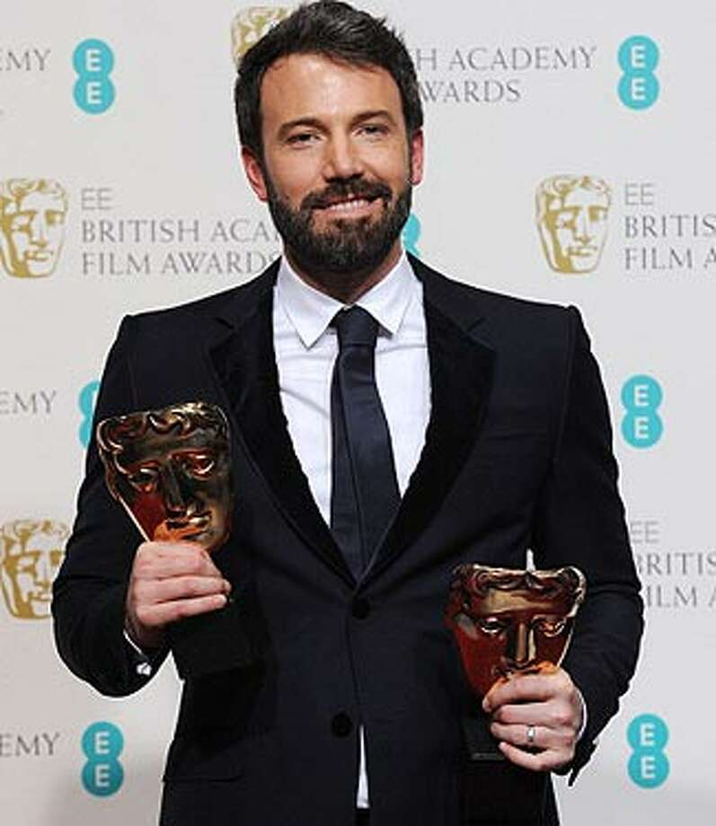Ben Affleck with his British Academy of Film and Television Arts Awards for best picture and best director.